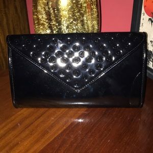 Aldo black patent clutch with shoulder chain